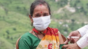 On August 4, 2021, at the Pipalchauri Health Post in Duhun in Nepal's far west Darchula District, 47-year-old Damara Bham receives the COVID-19 vaccine as part of a vaccination drive.