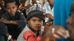 A boy photographed at a refugee camp in eastern Sudan is one of over 25,000 children who have fled Ethiopia's Tigray region to escape violence since early November.