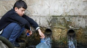 In Wadi El Jamous, Lebanon, Adham, 11, fetches water for his family from the village well.