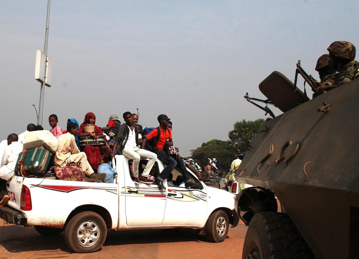 People ride from the airport after missing flights out of Bangui in December. Violence in the Central African Republic has now displaced more than 900,000 people.