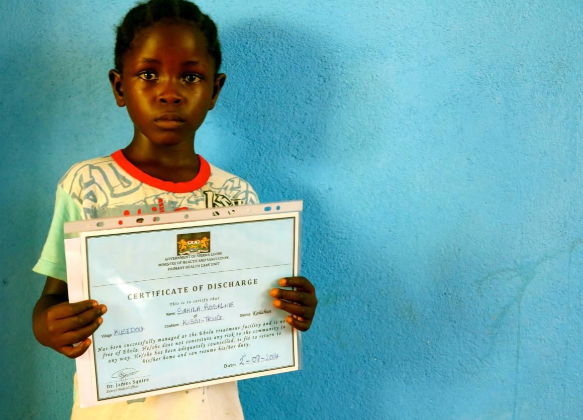 Rose shows off her certificate of good health that was issued to her by the Ministry of Health and Sanitation when she left the Ebola treatment center in Sierra Leone.