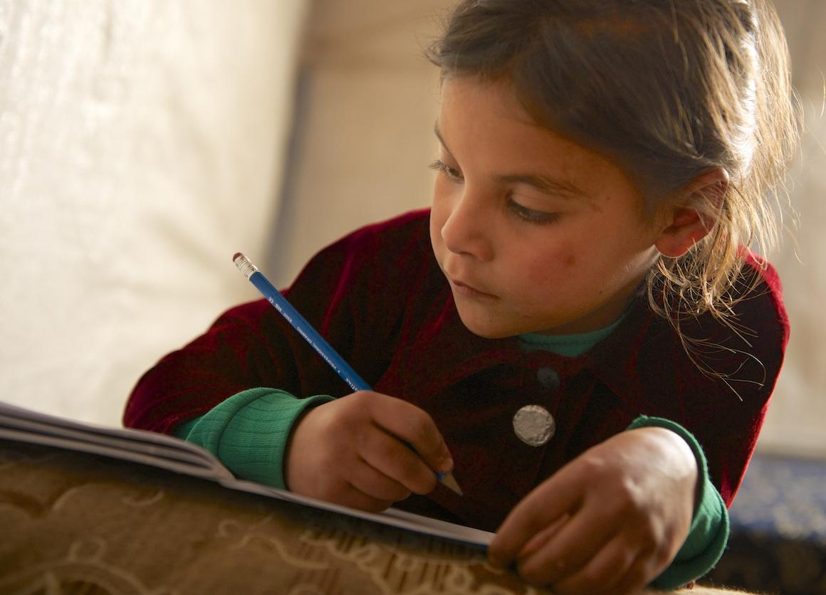 A child studies at the Za'atari camp for Syrian refugees in Jordan.