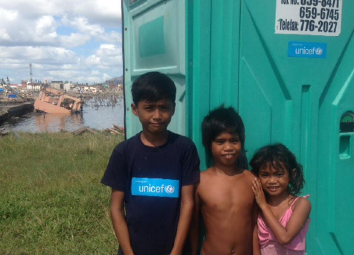 UNICEF's distribution of portable toilets in Tacloban helped limit the spread of disease after Typhoon Haiyan. © UNICEF/PFPG2013P-0293/KENT PAGE