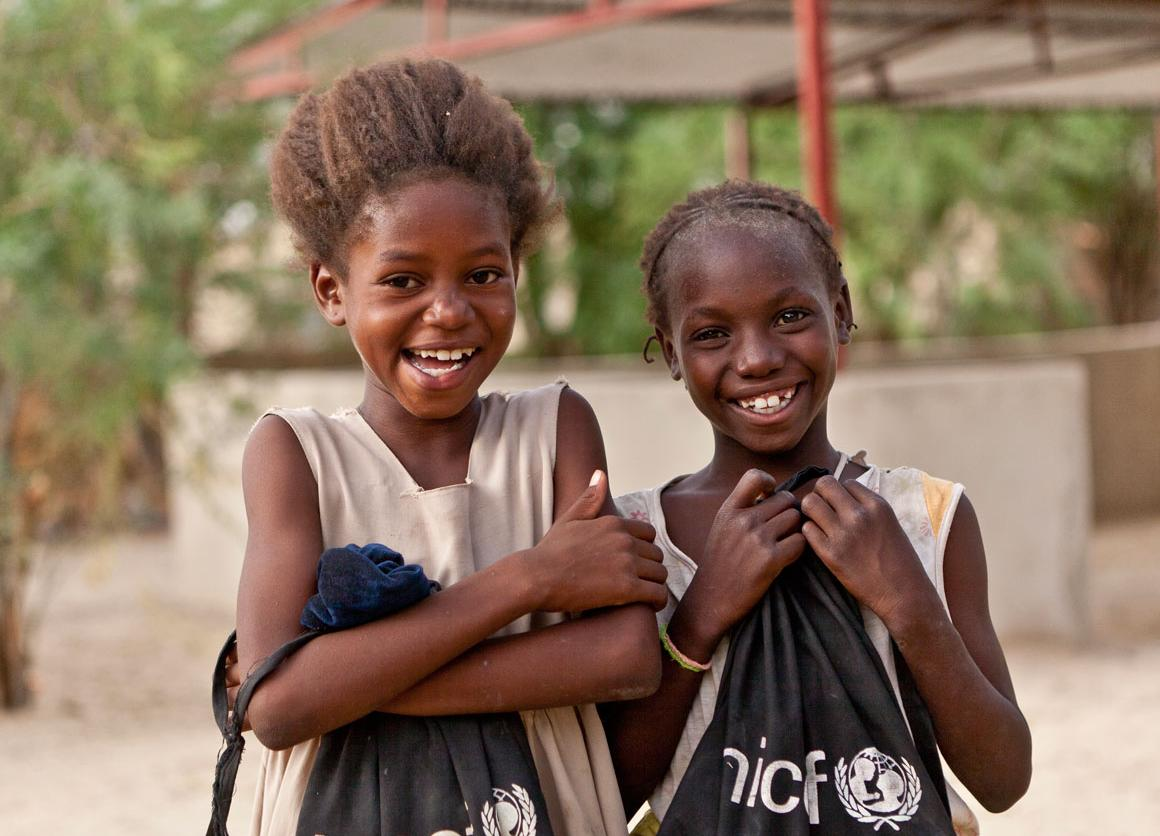 Here, Aïssata Fondo (10) on the left and Maïmouna Cissé (10) on the right are pictured with their UNICEF school bags at the Alpha Moya school in Timbuctu, Mali 2013