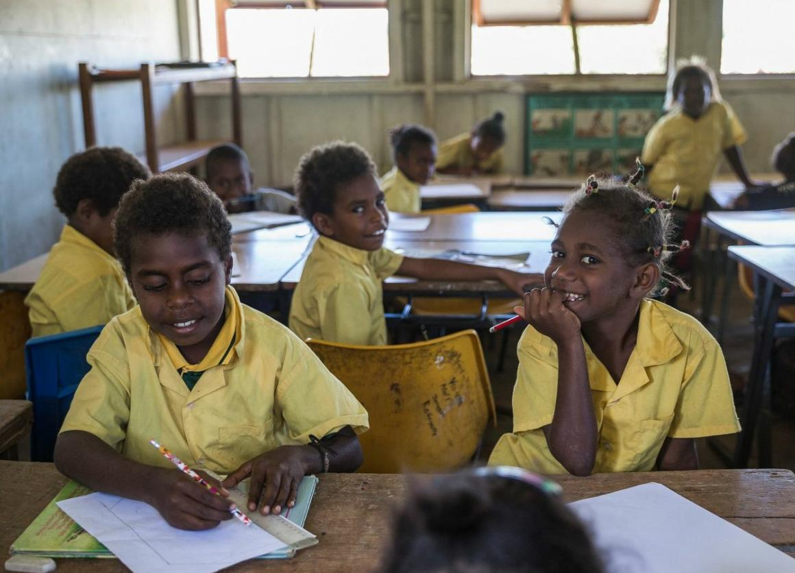Children return to school with the help of UNICEF supplies weeks after Cyclone Pam hits Vanuatu.