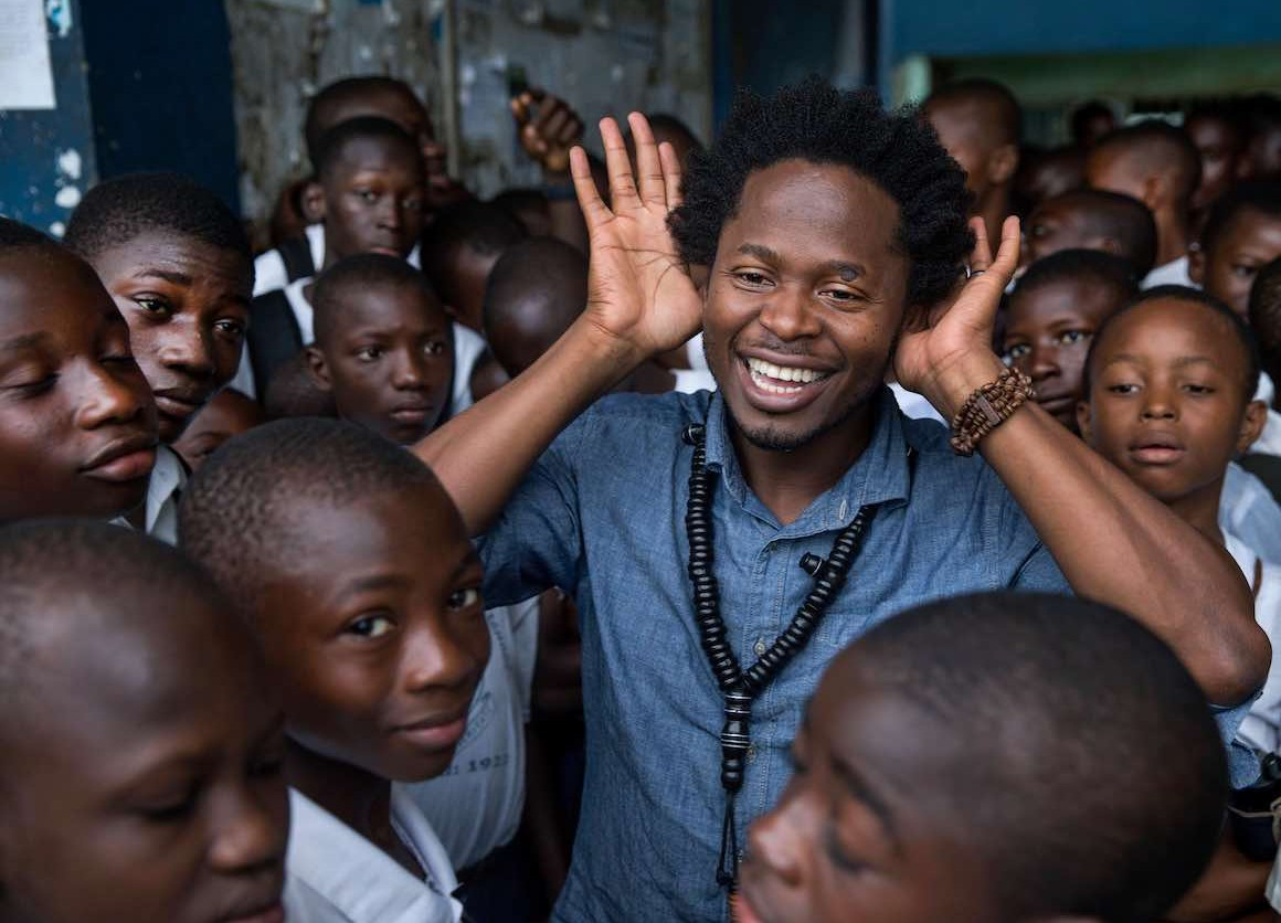 Former child soldier, and author Ishmael Beah visiting the school he studied in as a child July 1, 2016 in Freetown, Sierra Leone.