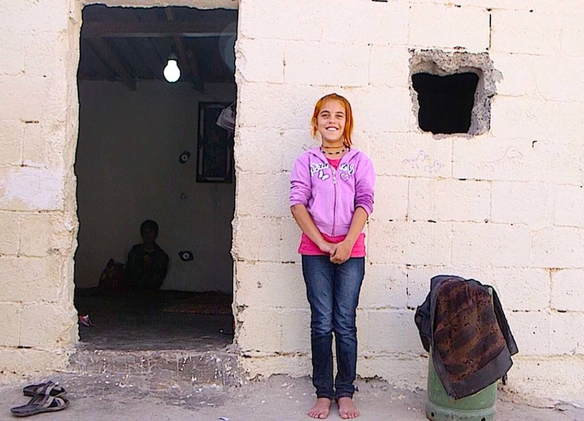 Displaced Iraqi girl, living in refugee camp, speaks about what she lost.