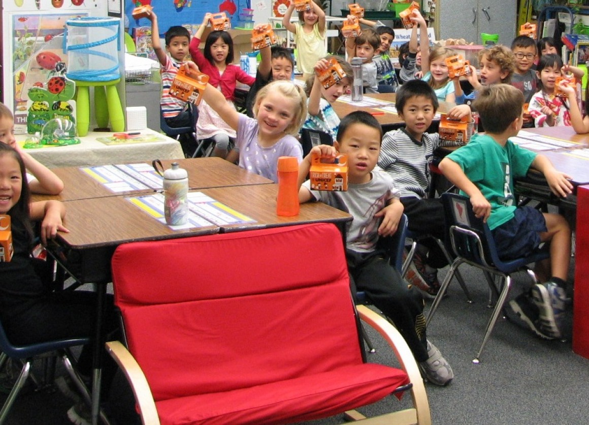 1st Graders at Bell School show off their Trick-or-Treat for UNICEF boxes