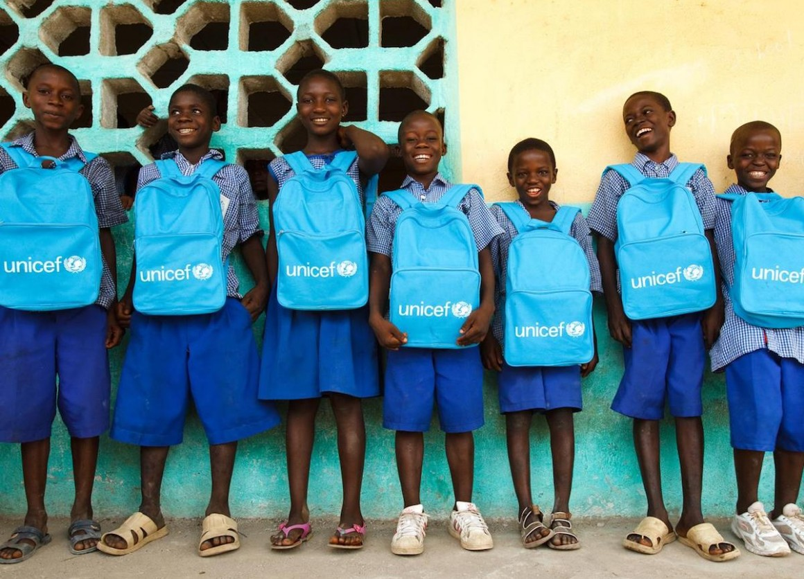 Students elected to the school government line up with their UNICEF backpacks line up outside the primary school in Bloleu Village in Dix-Huit Montagnes Region, Sierra Leone.