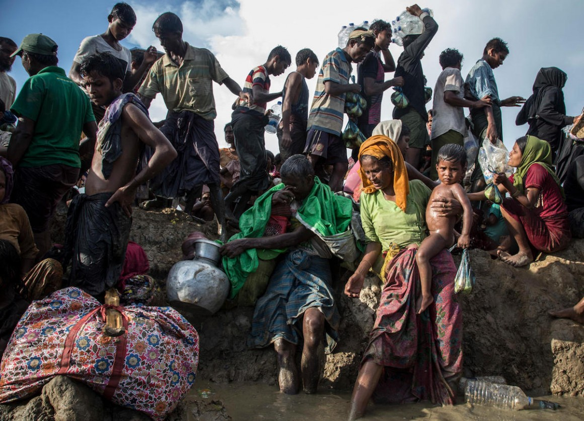 On October 16, 2017, Rohingya refugees cross into Bangladesh in Cox's Bazar.