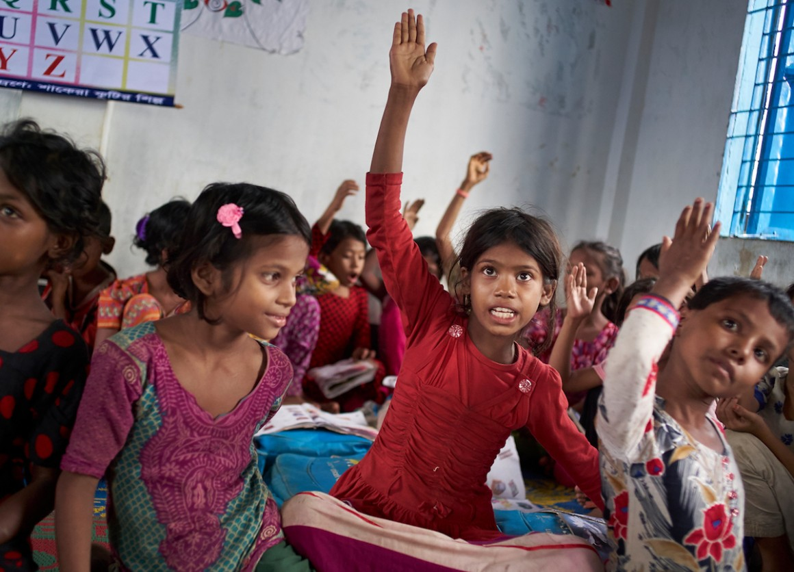"Eight-year-old Rohingya refugee Yasmin and other students at the ""Prajapatti"" (Butterfly) UNICEF learning center in the Kutupalong makeshift refugee settlement in Cox's Bazar, Bangladesh."