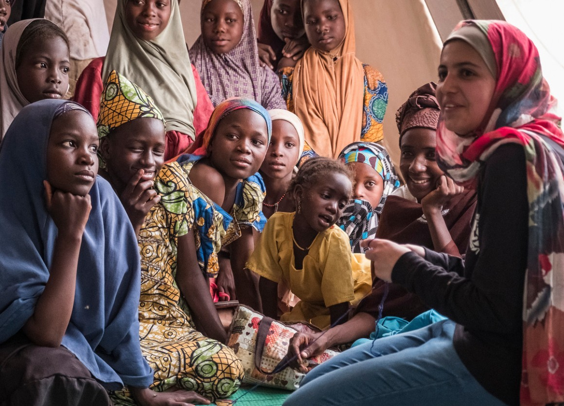 UNICEF Goodwill Ambassador and education activist Muzoon Almellehan meets with girls at a sewing class in a refugee camp in Chad.