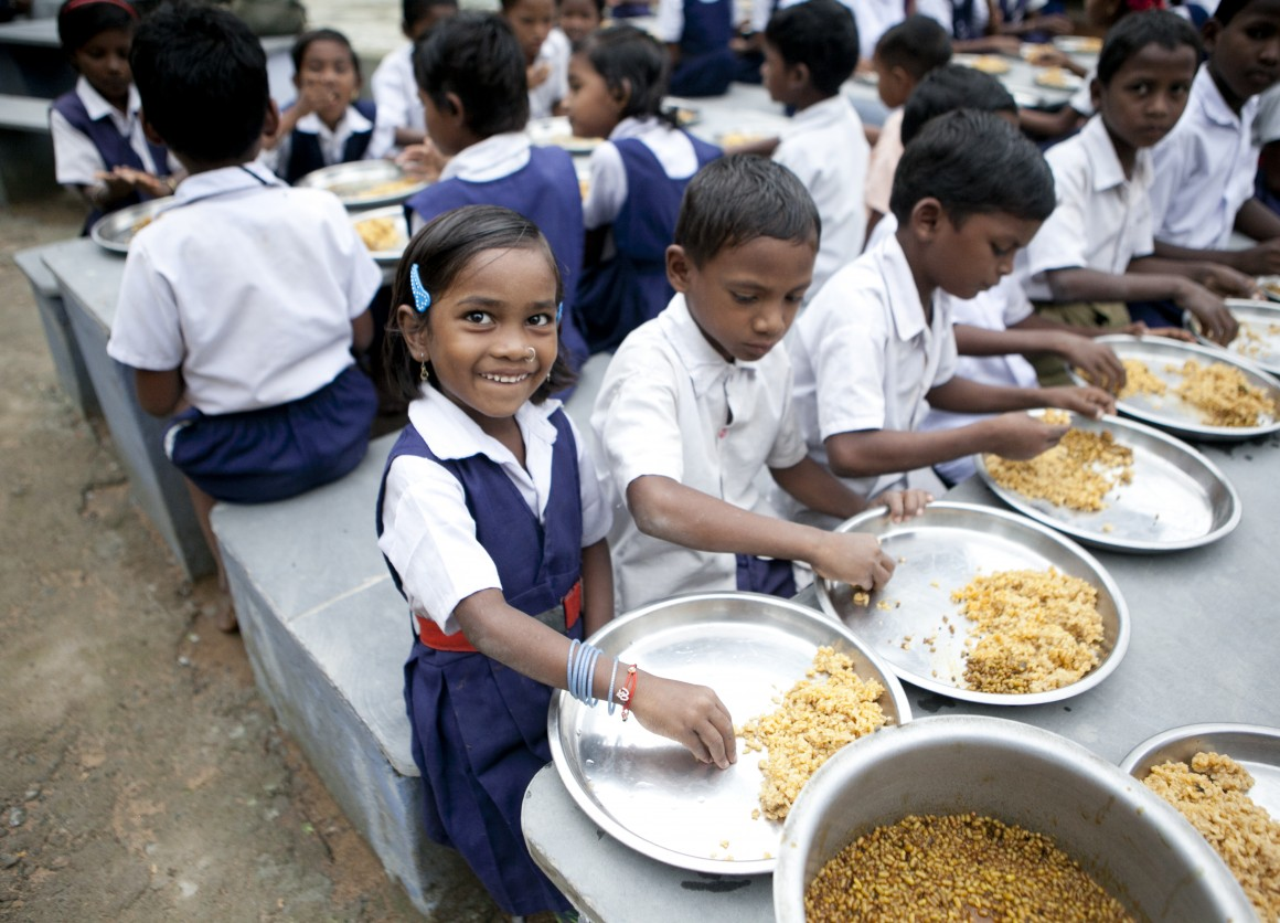 Children in India enjoying a meal at school