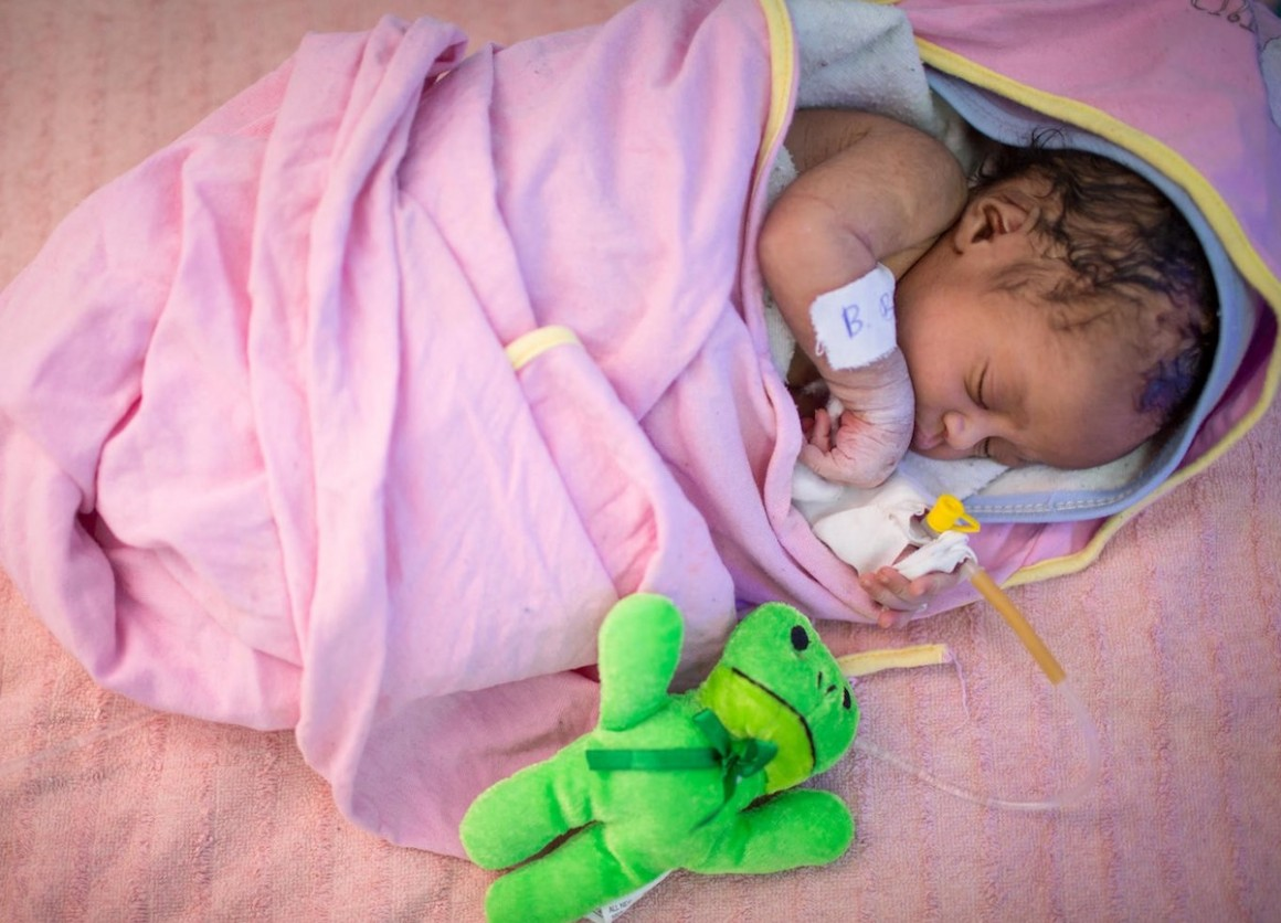 An infant sleeps in the neonatal intensive care unit at Assosa General Hospital in Benishangul-Gumuz, Ethiopia.