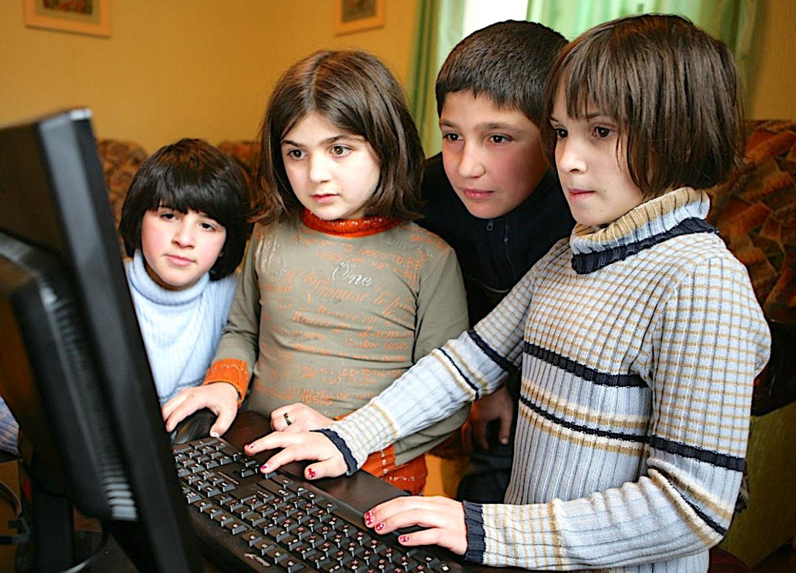 Children use a computer at a UNICEF-supported, small-group home in the southeastern city of Rustavi,