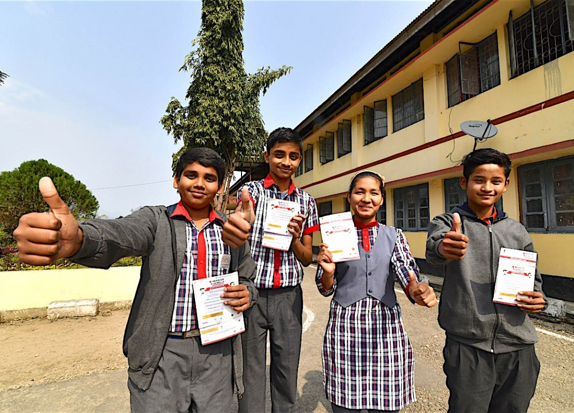 During one of the world's largest mass immunization campaigns, spearheaded by UNICEF and partners, students in India show their proof of measles/rubella vaccination.