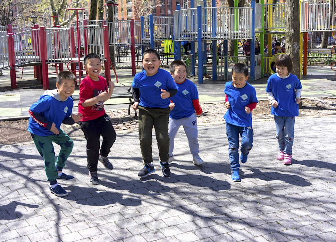 Students of P.S. 42 in New York City challenge each other to a running race to earn more Kid Power points.