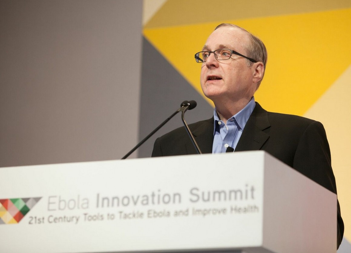 In 2015, Paul Allen committed $100 million to fighting the Ebola crisis in West Africa. At the Ebola Innovation Summit in April of 2015, Allen emphasized the importance of collaboration in the fight. Credit: Courtesy of Vulcan Inc.