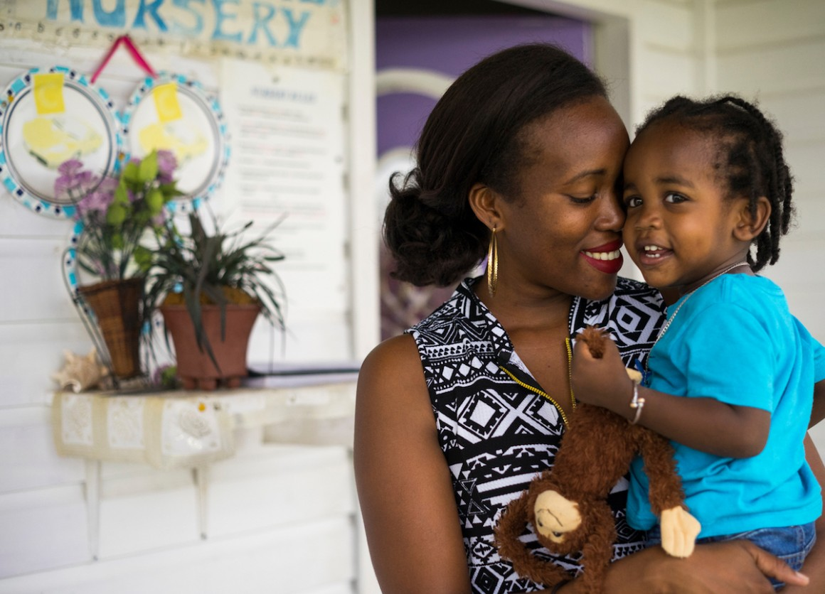 Denee, 28, picks up her 19-month-old son, Justice, from the daycare center where he stays while she teaches preschool on Nevis Island, St. Kitts and Nevis.