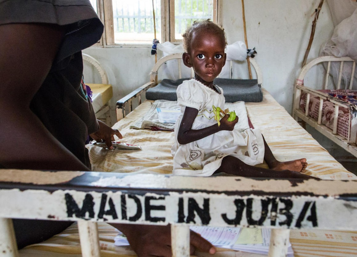 Diagnosed with severe acute malnutrition, two-year-old Maria awaits treatment at a UNICEF-supported hospital in Juba, South Sudan in October 2017.