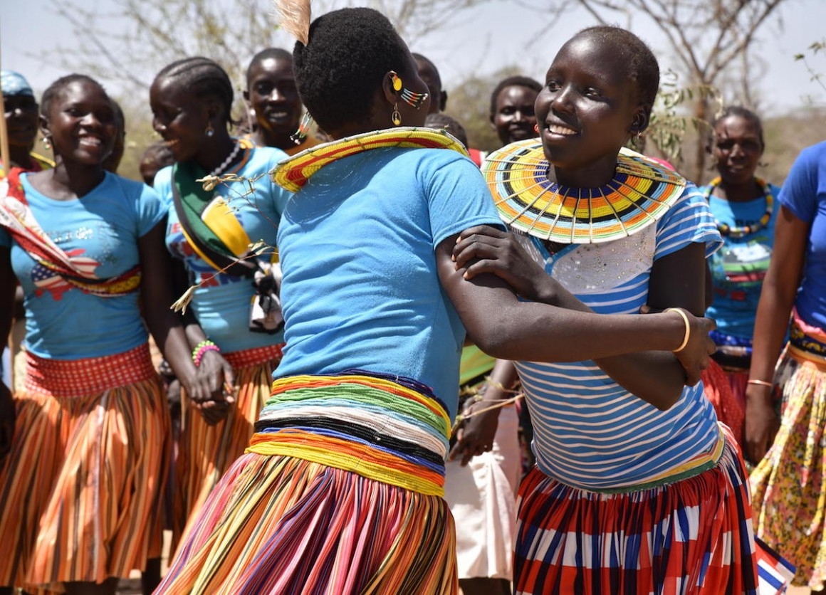 Adolescent girls and women from Ausikioyon village in Amudat District, Uganda celebrate after their village made a public declaration against Female Genital Mutilation (FGM).