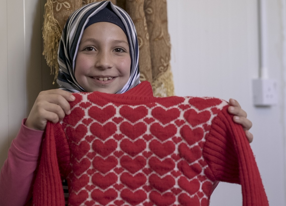Lama, 9, a Syrian refugee living with her family in the Za'atari camp, was able to get this warm sweater thanks to UNICEF's winterization support program.