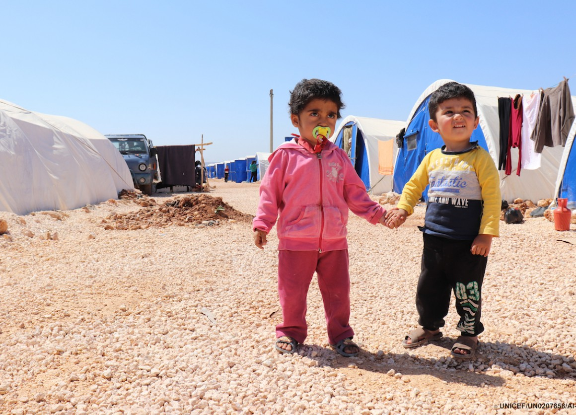 UNICEF USA's photo of the year features two young children from Syria photographed at the Fafin camp for displaced families located north of Aleppo.