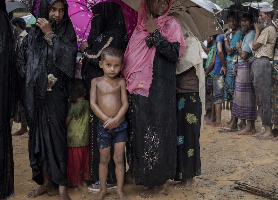 Sawkat Ullah, 6, is waiting in line for bamboo to reinforce the shelter they call home in a Rohingya refugee camp in Bangladesh.