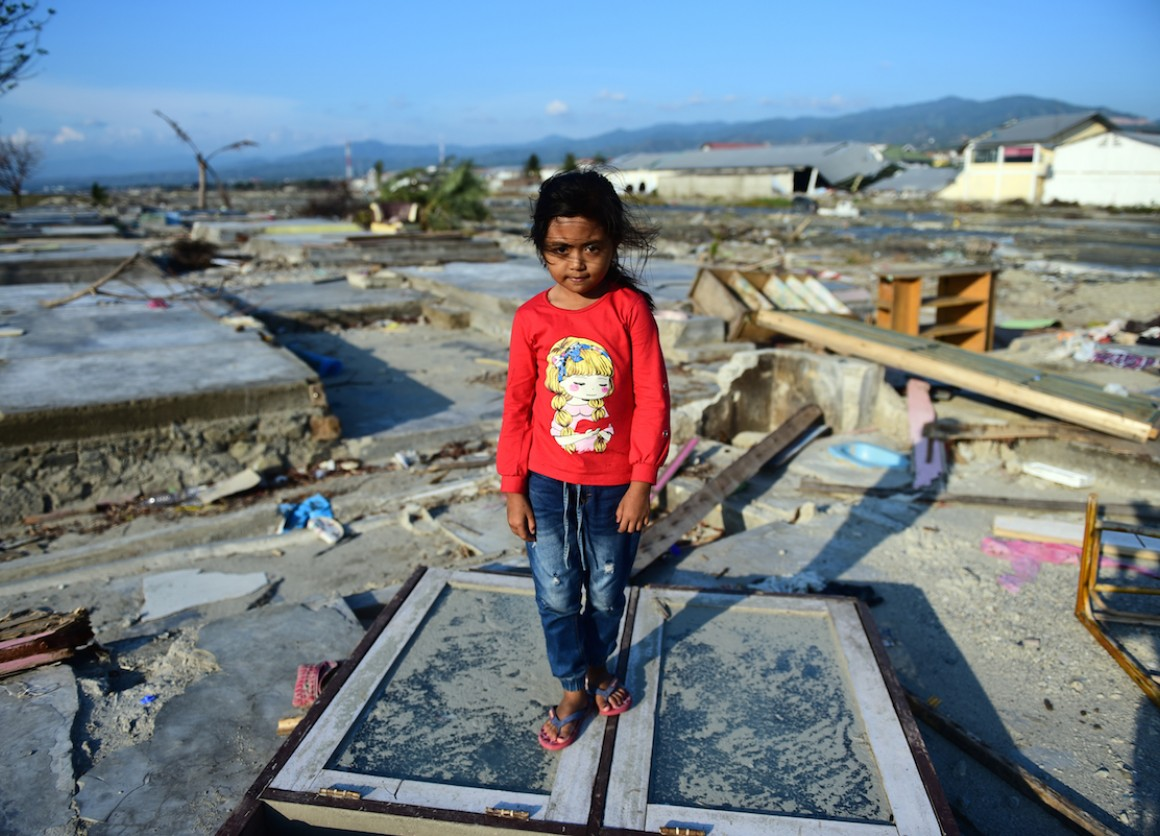 Marwah, 8, stands amid the ruins of her family's home, destroyed when a tsunami struck Sulawesi island, Indonesia on Sept. 28.