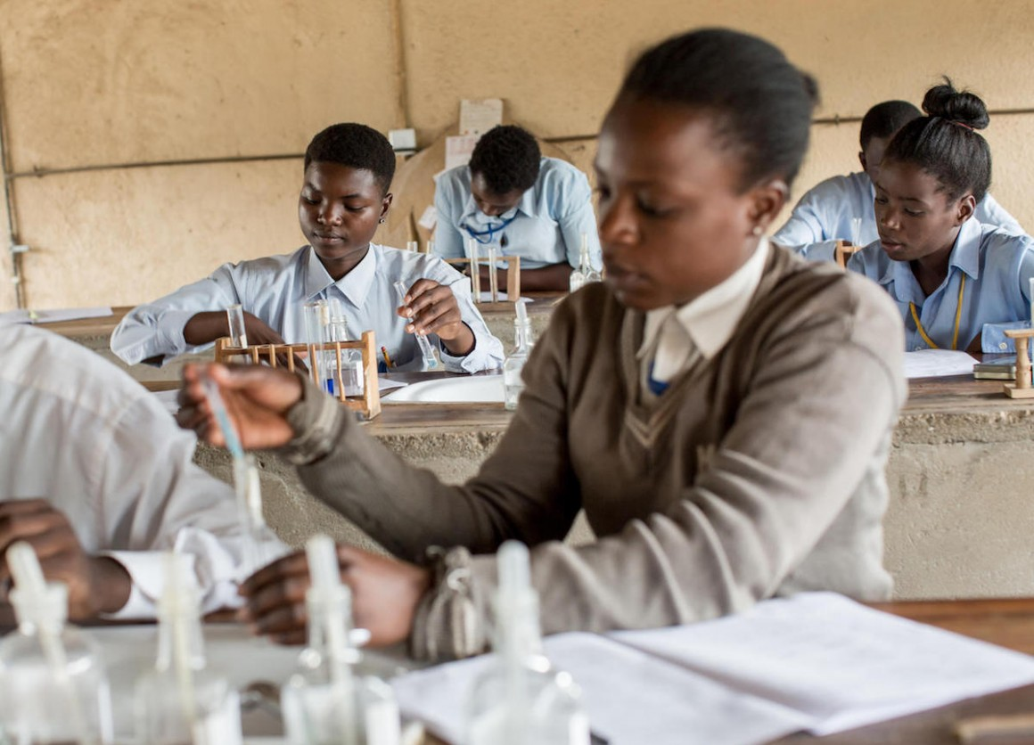 Adolescent girls conduct experiments during a chemistry at UNICEF-supported Kamulanga Secondary School in Lusaka, Zambia in 2016.