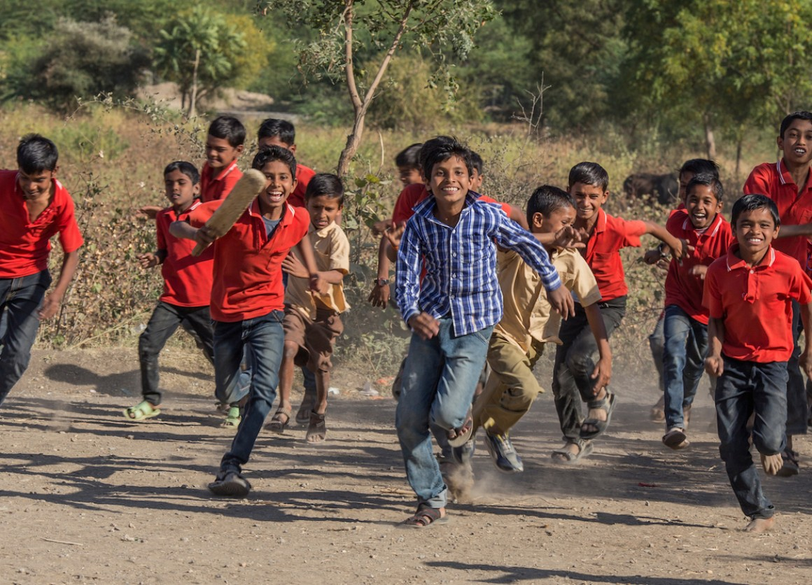 Primary school students in Aurangabad, Maharashtra state, India, after playing a cricket match organized by a UNICEF-supported program emphasizing social change through sport.