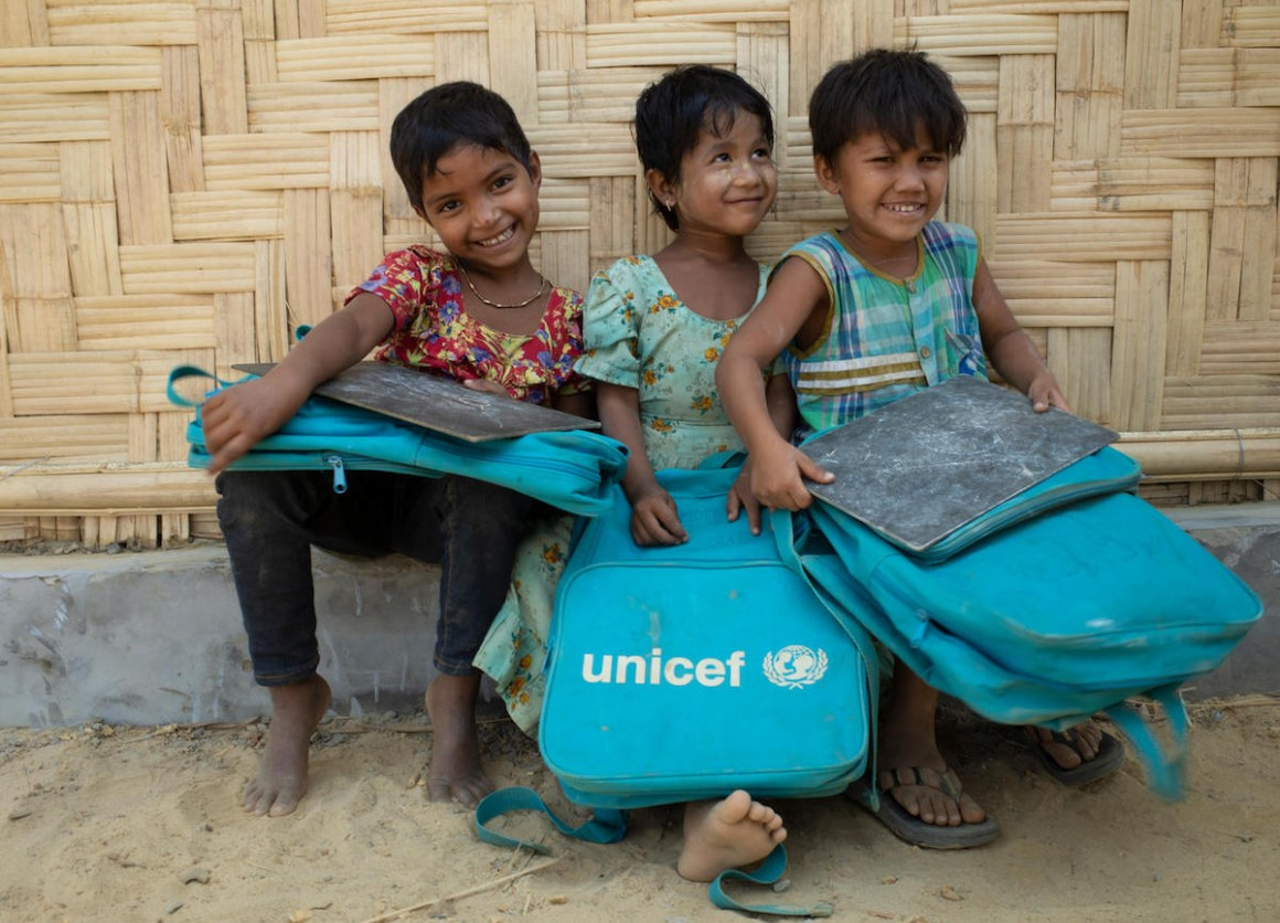 Rohingya girls sit outside a UNICEF-supported Learning Center in Balukhali camp for Rohingya refugees in Cox's Bazar District, Bangladesh on 4 March 2018.