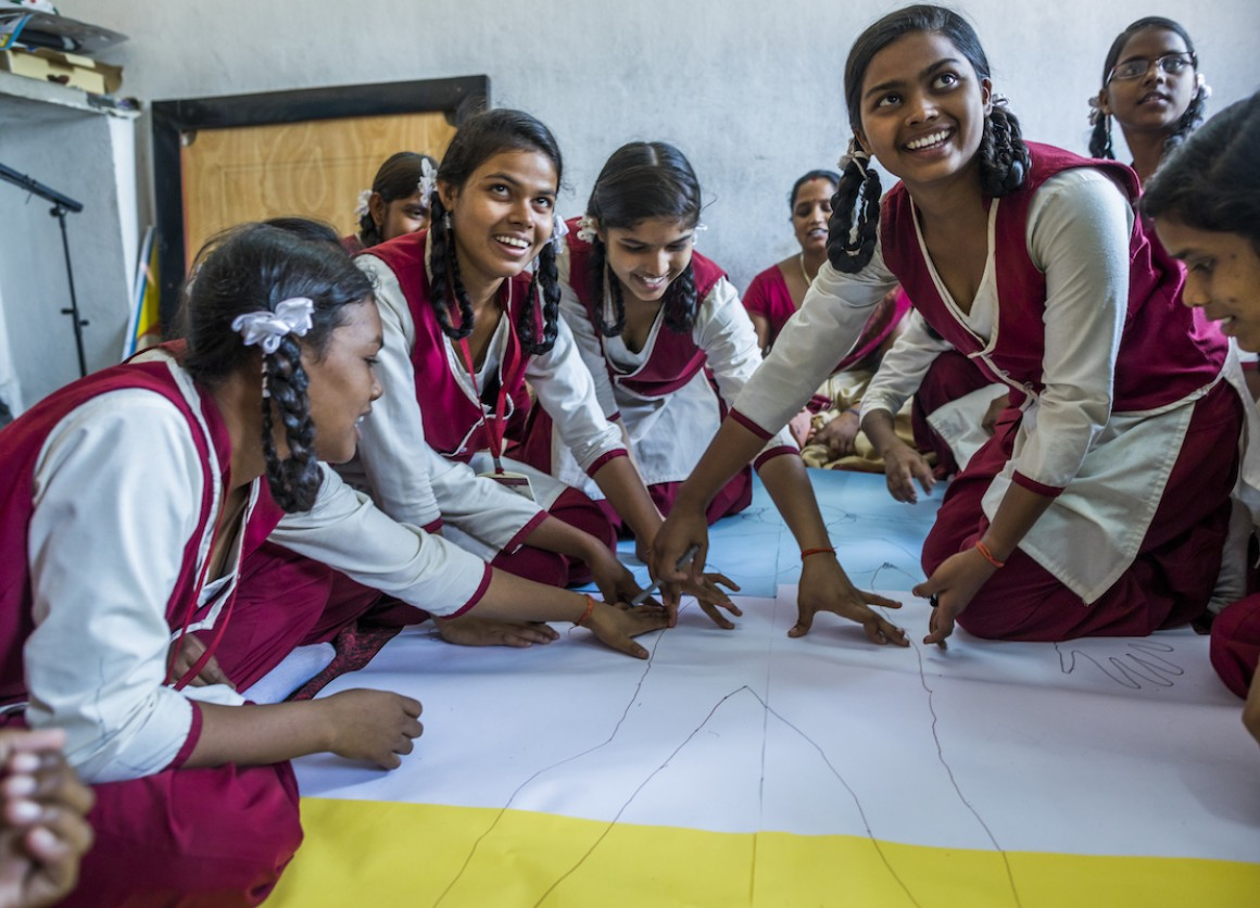 Adolescent girls in Jharkhand, India, participate in a body-mapping activity, part of a UNICEF-supported program to improve menstrual health and hygiene and help girls stay in school.
