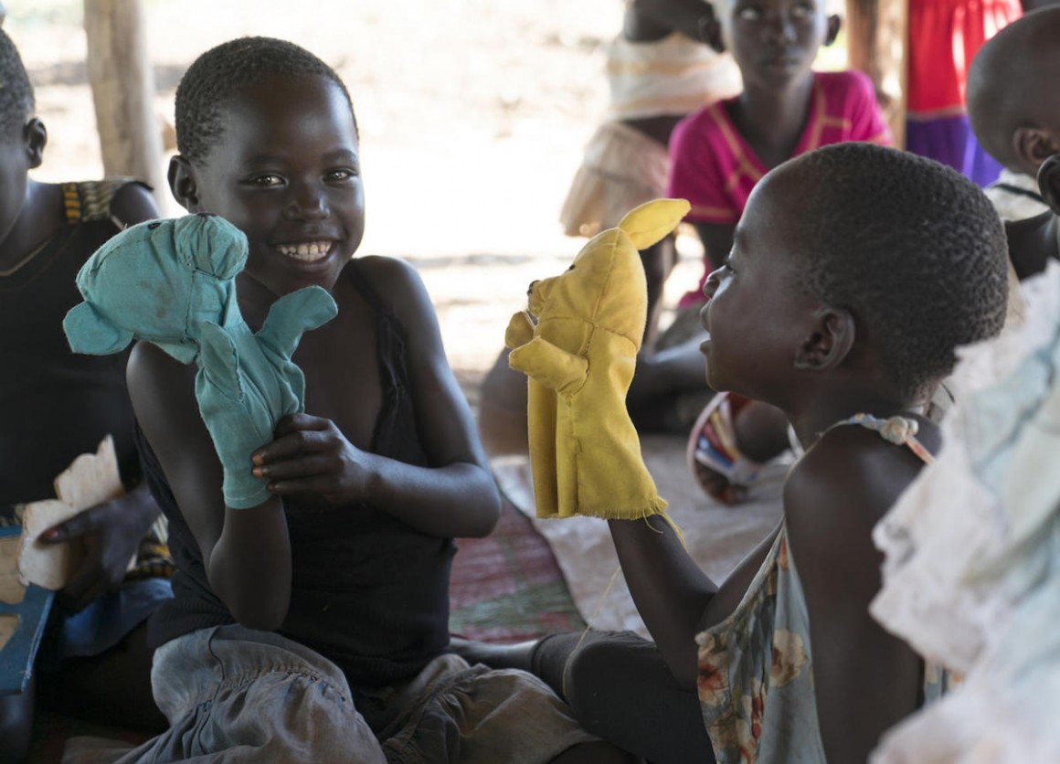 South Sudanese refugee children play with locally made hand puppets in Yumbe district, Uganda.