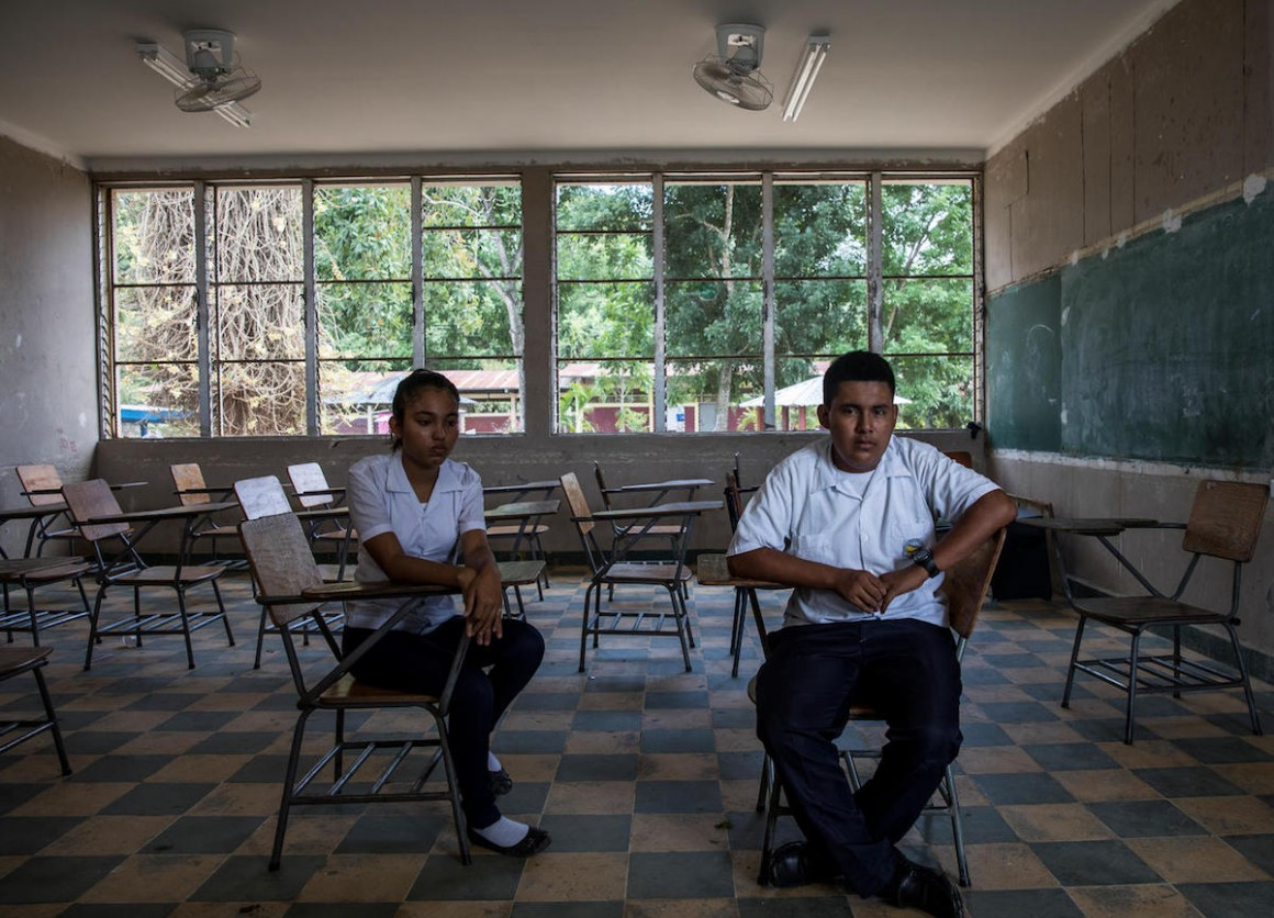 Josseline, 17 (left), Darwin, 16, and their friend Henry were targetted by bullies in Villanueva, Honduras. Henry committed suicide.