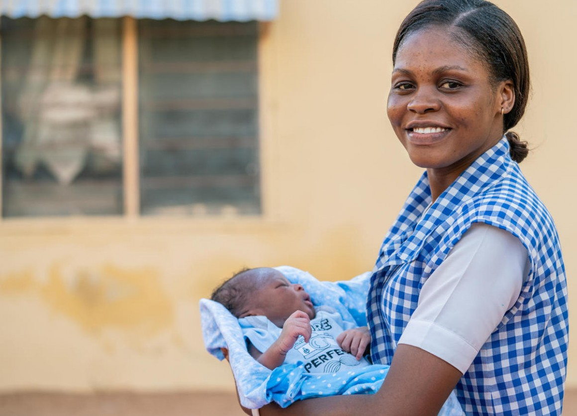 Amilia Mathew, 28, with newborn baby boy Sulaiman outside his home in in Yola, Nigeria.