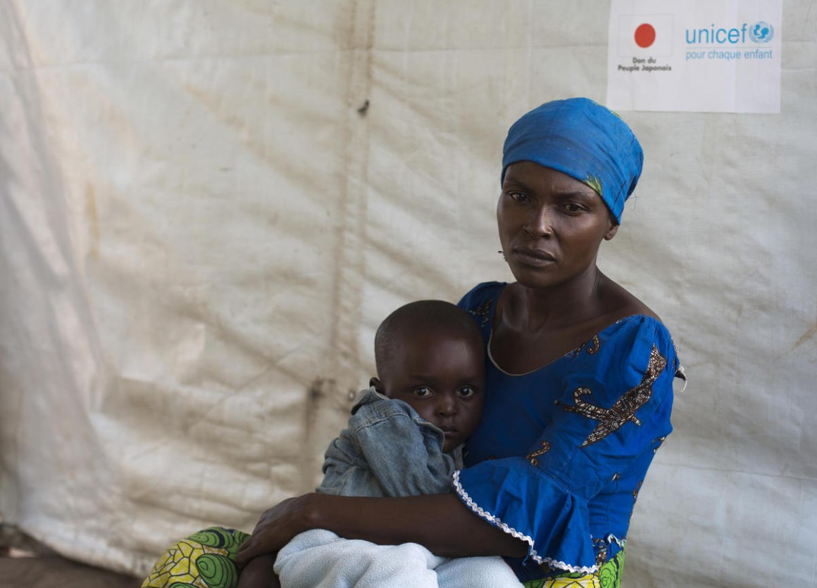 Zuliya Nboyo brings her son, Kayoka, 2. to a community health worker at an Internally Displaced Persons camp in Kalemi, Tanganyika province, Democratic Republic of Congo in November 2018.