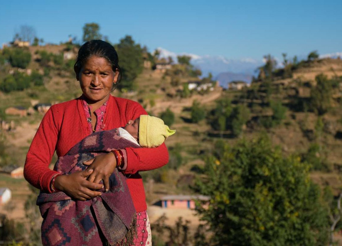 Janaki Odh with her 16-day old baby girl Nisha in Joshibunga, a village in Baitadi District, far western Nepal. Sixteen days before we captured this story, she gave birth to a baby girl, Nisha. She had a home delivery, but halfway through she noticed that