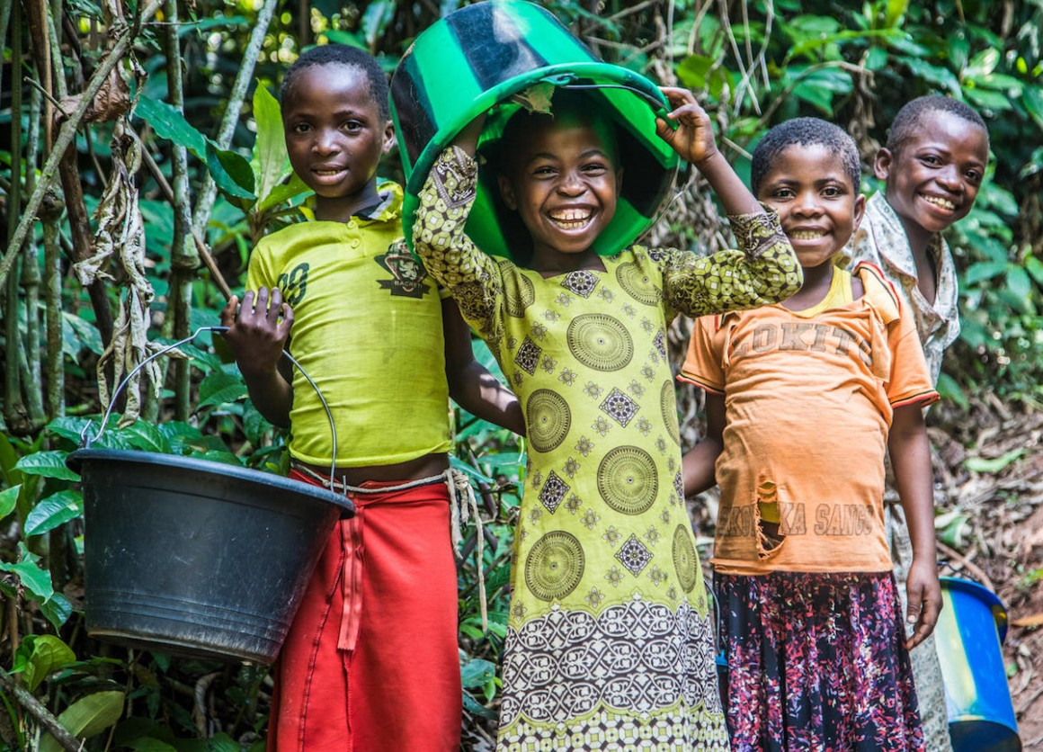 Children clown around while collecting water at a UNICEF-built pumping and distribution station near Kananga, Democratic Republic of Congo, in October 2018.