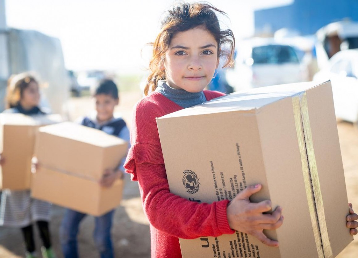 "Reem, 10 years, has five sisters and two brothers – between 2 and 15 years. Her family are Syrian refugees and came to Jordan six years ago. She has just received her winter clothing kit from UNICEF and its partner Mateen. ""In winter it gets too cold. The"