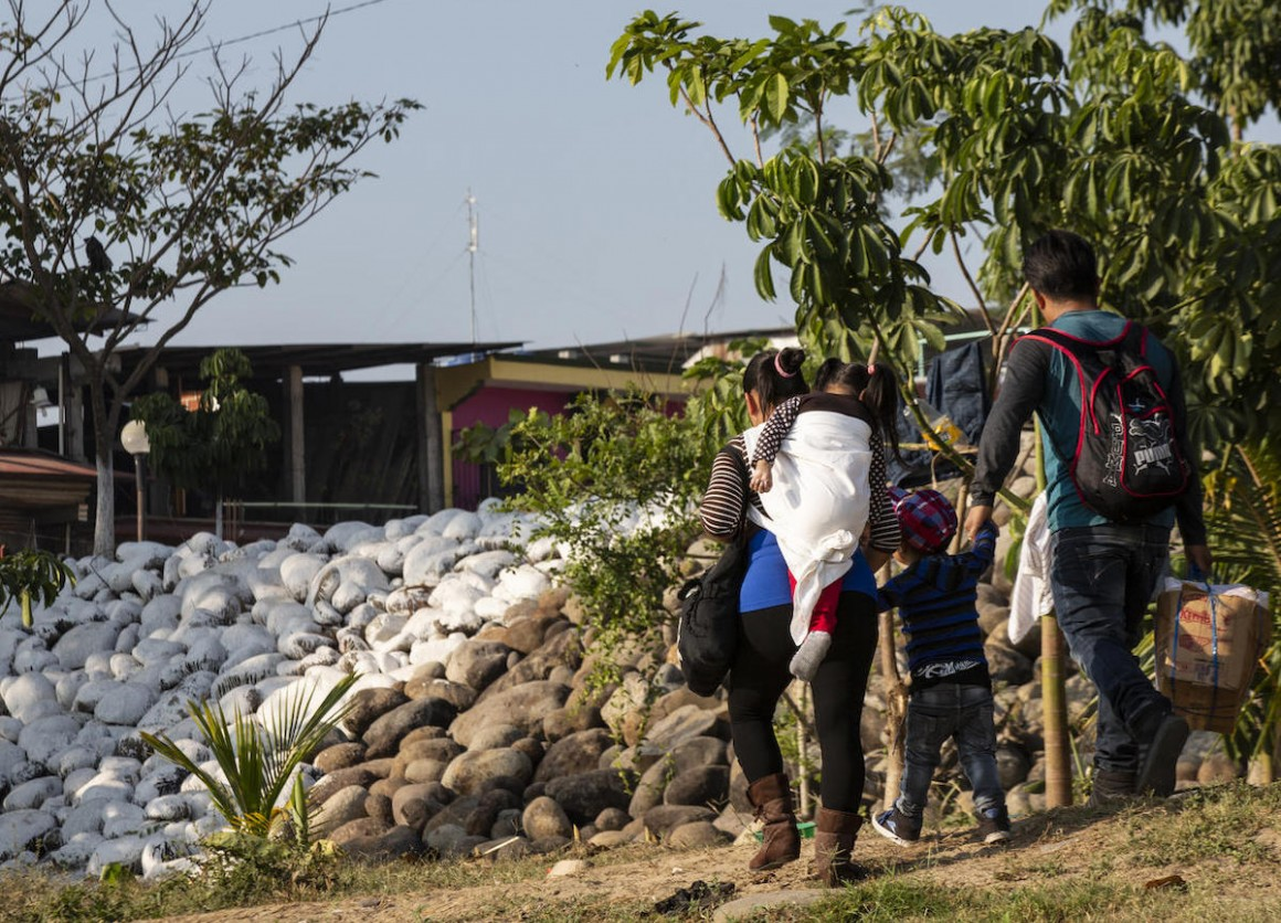 A family crosses the Suchiate River at the Mexico-Guatemala border in Ciudad Hidalgo, Mexico on January 31, 2019.
