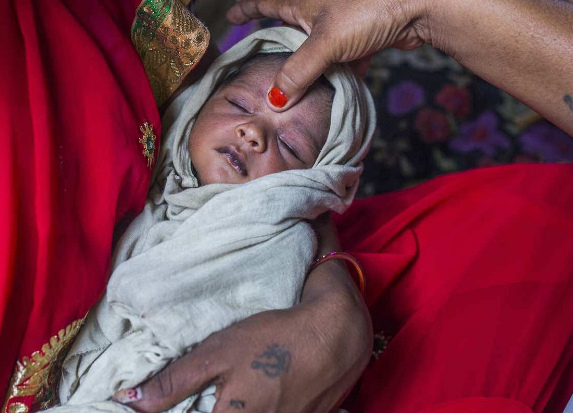 A UNICEF-IKEA Foundation supported health care worker makes a home visit to see how this newborn from a village in northern India is doing. After a safe delivery, a newborn requires tender care to ensure safe passage through the first thousand days life.
