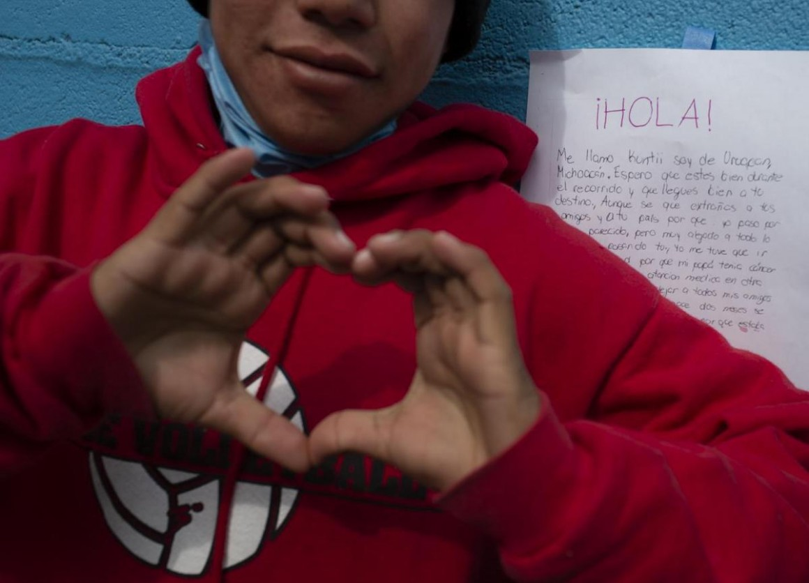 A boy reacts to a letter of support he received from a Mexican teenager at a shelter for unaccompanied migrant adolescents in Tijuana, Mexico in February 2019.