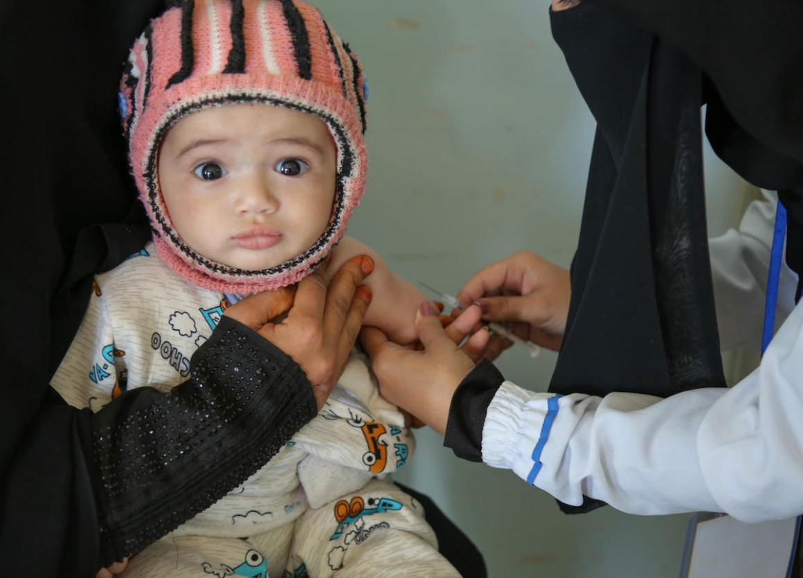 A child is vaccinated at a health center in Sana'a, Yemen during a UNICEF-backed measles and rubella vaccination campaign in 2019.