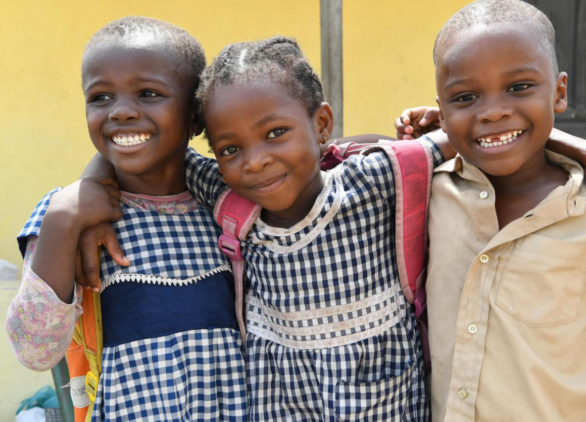 Happy friends leaving their UNICEF-supported school in Gonzagueville, a suburban of Abidjan, the capital of Côte d'Ivoire, in 2019.