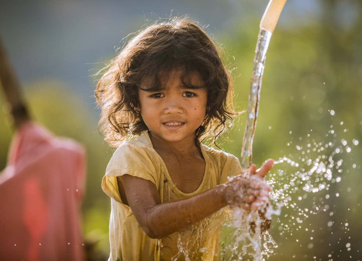 Pinang Thi Thuy, Raglai ethnic minority 5 years girl, enjoys her family's clean water source in Bac Ai, Phuoc Hoa, Ninh Thuan. Thuy's family was suffered great crop failure due to the historical drought in Viet Nam, 2015-2016. In addition her younger brot