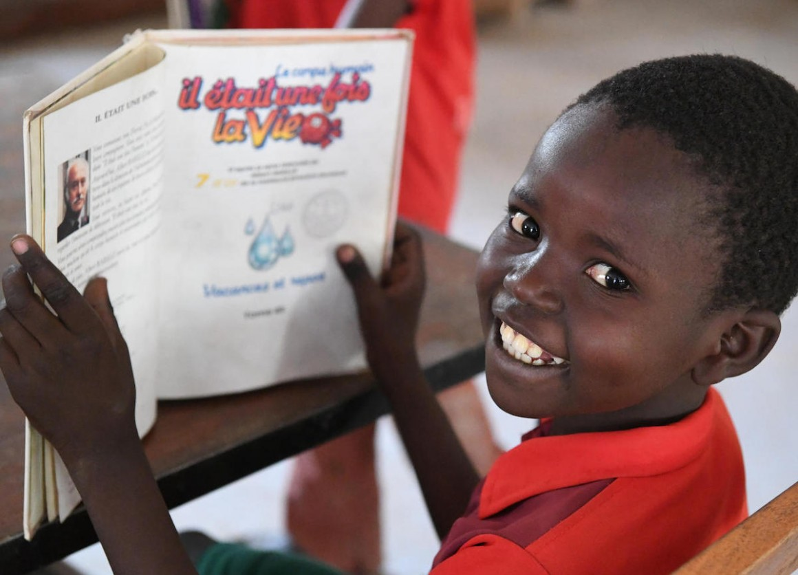 This boy is reading a book in the library of a cultural center in Mongo, Chad.