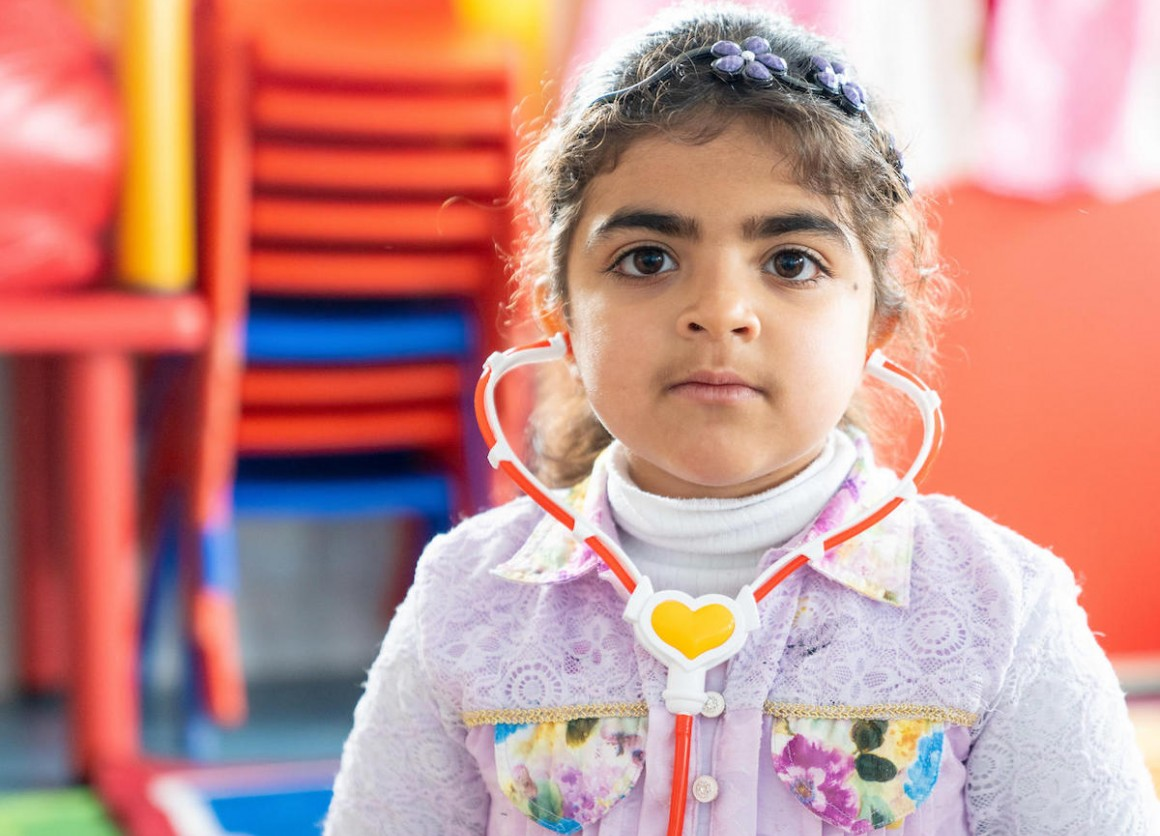 Haneen, 5, in her new kindergarten classroom, built and equipped by UNICEF, in Za'atari Refugee Camp in Jordan.