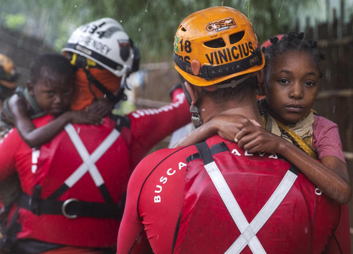 On April 28, 2019, Brazilian military firefighters rescue children in the Shibahuri area of Pemba, Mozambique after heavy rains poured down in the wake of Cyclone Kenneth.