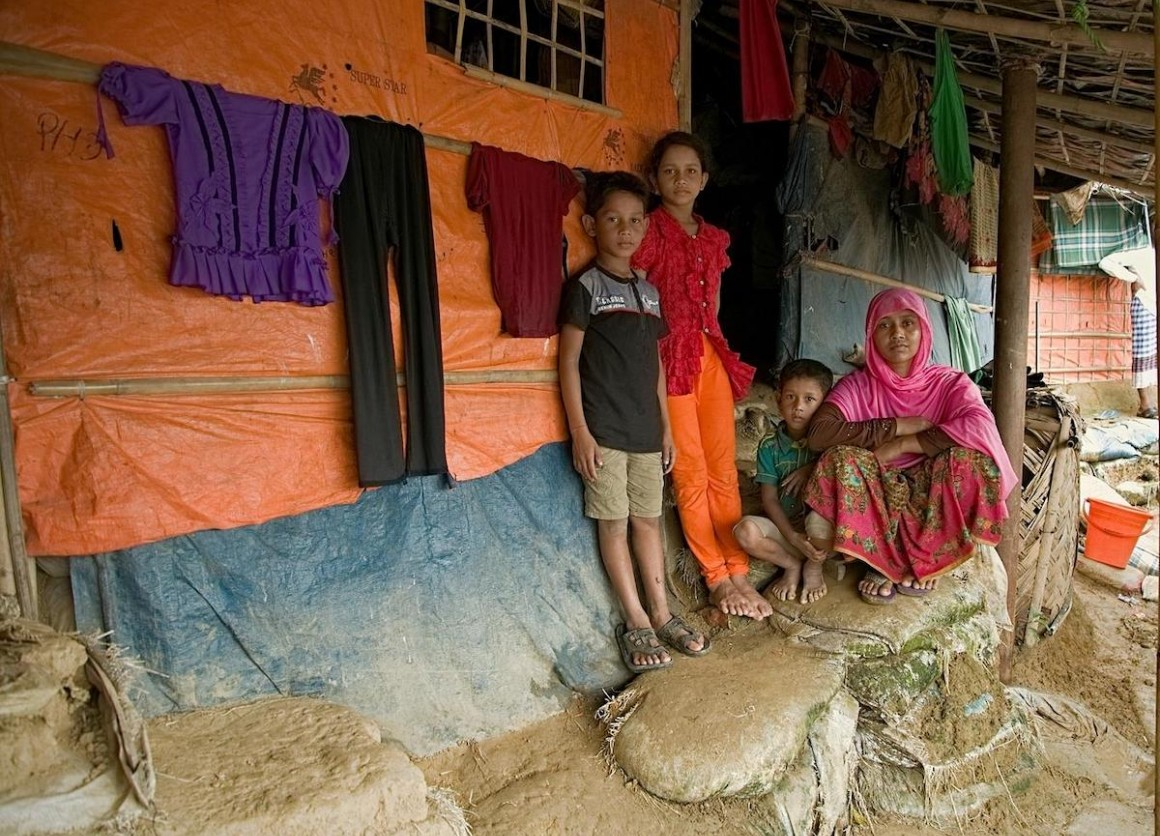 On 11 July 2019 in Bangladesh, (left-right) Mohammad Jonayed, Jannatul Noor, Mohammad Shoyef and Ramjana Begum outside their shelter in Jamtoli camp in Cox's Bazar.